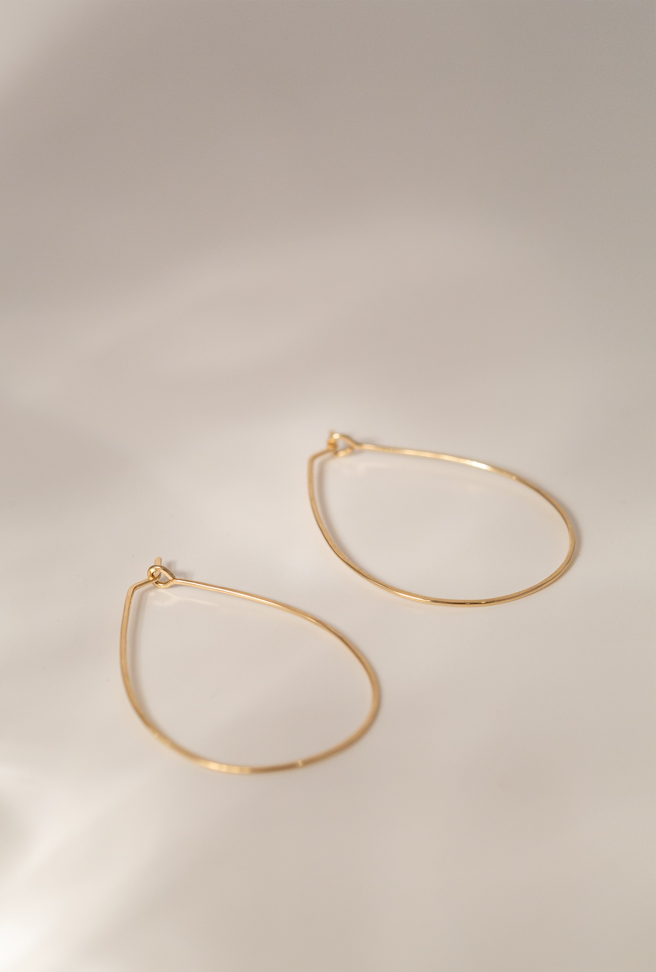 Med Float Teardrop Earring P