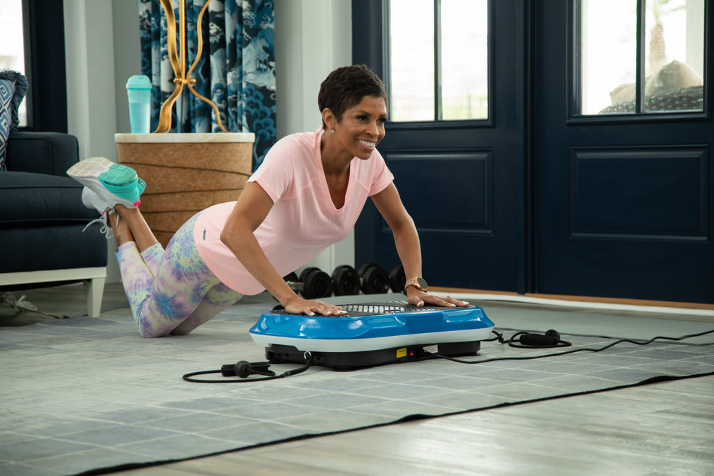 woman working out on a vibration plate
