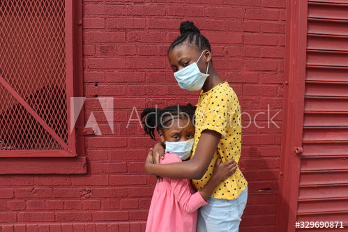 African American Girls Hugging Wearing Surgical Masks