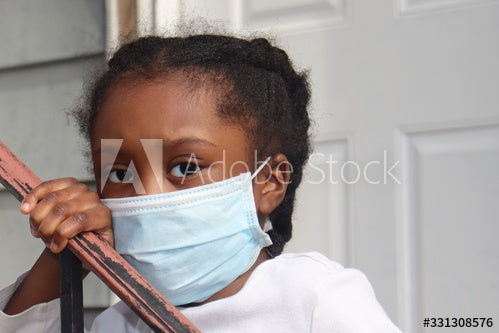 Kid wearing surgical mask outside