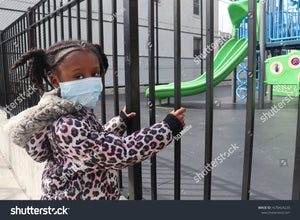 This Little girl wearing face mask outside playground just wants to play ...