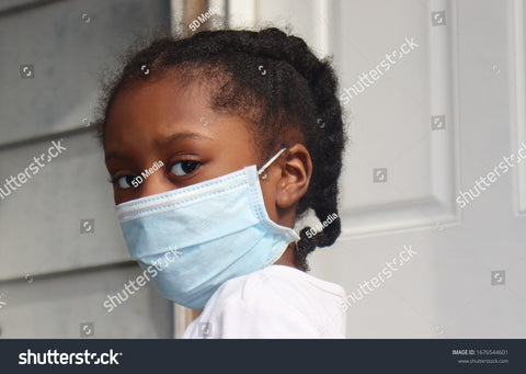 kid wearing surgical mask