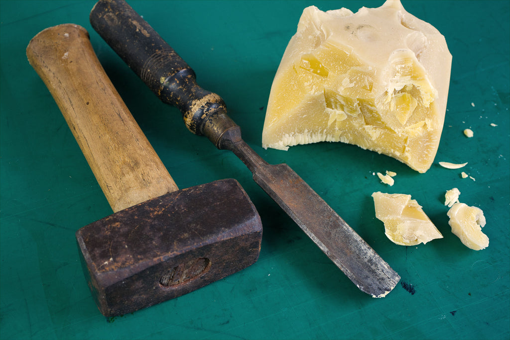Beeswax block broken up with hand tools in order to make Formula 5 wax