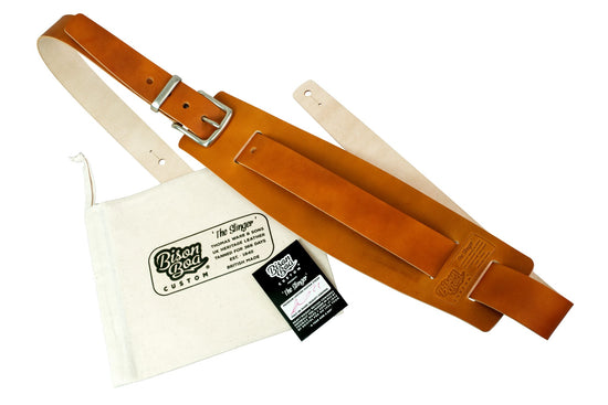 Guitar Strap - The Slinger in Dust Bowl Tan with packaging showing.