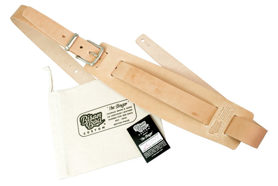 Guitar Strap - The Slinger in Natural Oiler with packaging showing.