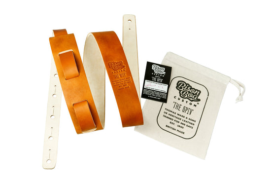 Guitar Strap - The Spiv in Dust Bowl Tan with packaging showing.