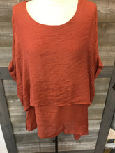 Rust tiered dolman sleeve top