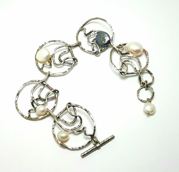 HAMMERED STERLING BRACELET WITH PEACOCK BUTTON PEARLS