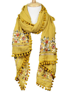 EMBROIDERED SCARF WITH POM POMS | MUSTARD