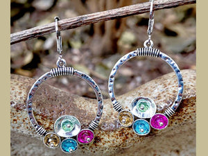WORN SILVER HOOPS WITH MULTICOLORED RESIN DISKS