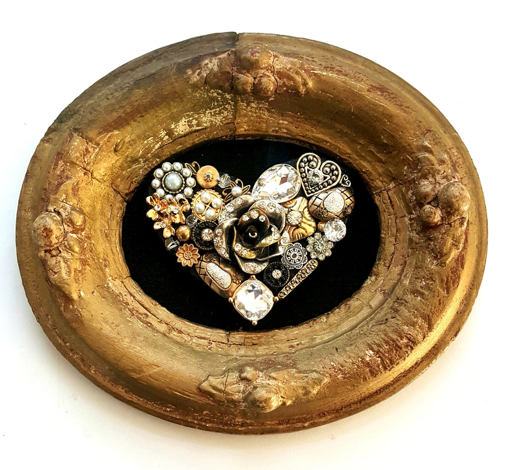 Handmade bejeweled heart created from vintage jewelry in oval frame