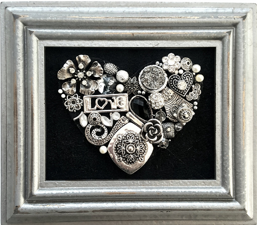 Handmade bejeweled heart created from vintage jewelry in silver frame.