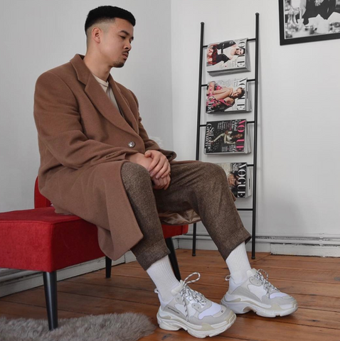X shares suits with sneakers