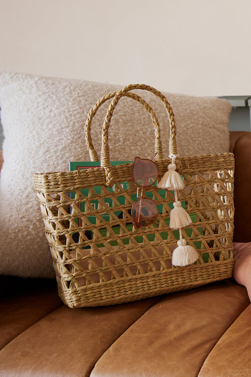 FREEDOM WOVEN STRAW TASSEL TOTE