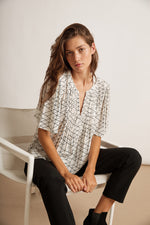 ELLIE GEOMETRIC RAYON GAUZE V-NECK TOP