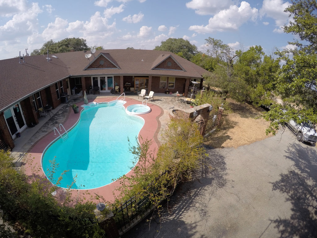 SOLD!  4 Bedroom 4 Bath Brick Home on 20+/- Acres with pool in Lampasas County Texas