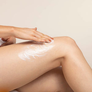 sweet almond and sea kelp moisturizer product sample on leg