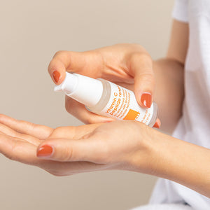 vitamin c peptide renewal serum image of women holding product
