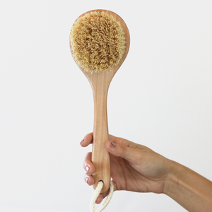 sisal brush in hand to show realistic size