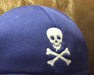 SKULL AND CROSSBONES.  SMALL,  SIMPLE DESIGN
