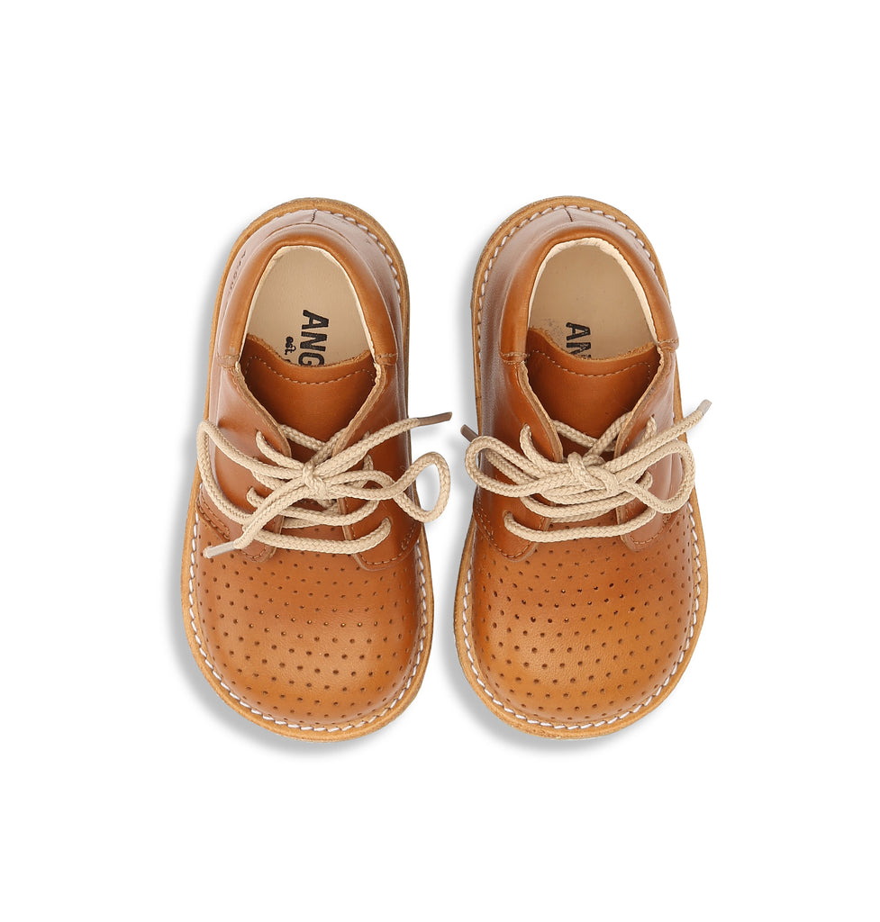 Starter lace-up shoe w. hole pattern