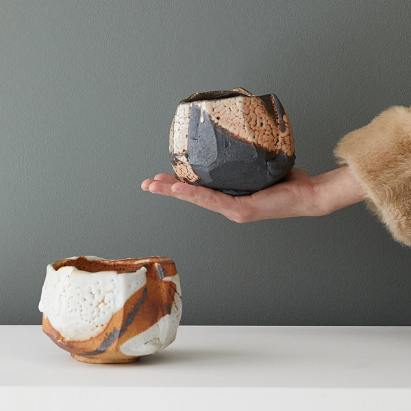 Elena Renker Faceted Tea Bowls with Hand for Scale