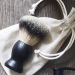 Meraki Mens Shaving Brush Laying on Meraki Bag