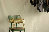 Harry Allen Reality Bank in the Form of a Pig Gold Piggy Bank on Chair