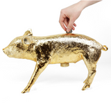 Harry Allen Reality Bank in the Form of a Pig Gold Piggy Bank with Coins Being Inserted