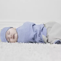 Merino Kids baby dressed in Cocooi Babywrap Set in Sky Blue Swaddle and Beanie