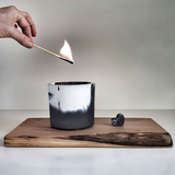 Blush Concrete Soho Candle being lit with match