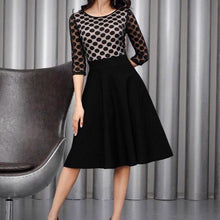 Opt for an elegant silhouette in the Polka Dot Casual Swing Dress, black