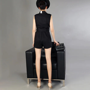 Perfect for work or a formal occasion, this Stylish Tux Front Stripe Playsuit, Black & White is smart and easy to wear.