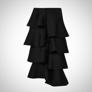 Asymmetric and fashionable, this Ruffle Fashion Midi Skirt is the perfect addition to your spring wardrobe.