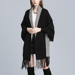 Complete your look with this Floral Tassel Knit Cape, Black.
