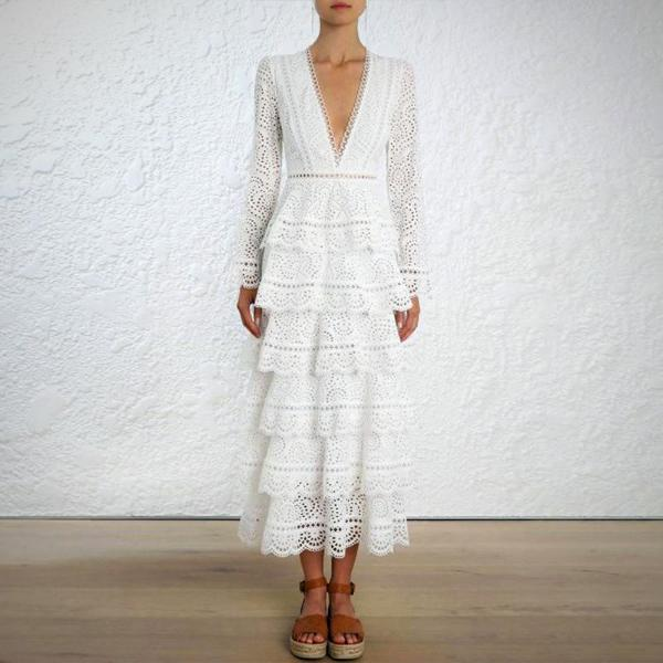 Refresh your dress collection for the warmer months with this lightly textured Ruffle Eyelet Midi Dress, White.