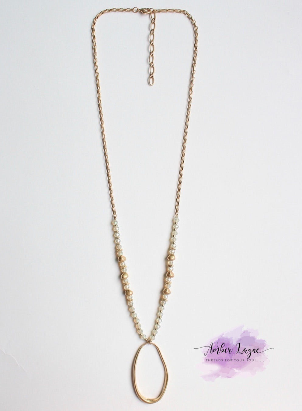 Gold chain and natural crystal with oval drop