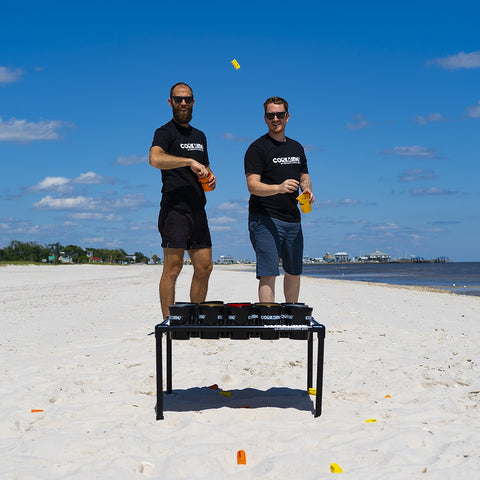 Two Guys Playing Corkaine Battle Beach Game On A Mississippi Beach