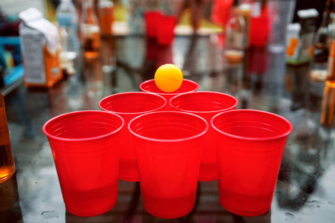 6-Red-Solo-Cups-On-A-Table-With-Orange-Ping-Pong-Ball