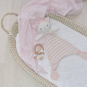 knitted pink and white striped cat comforter lying in basket