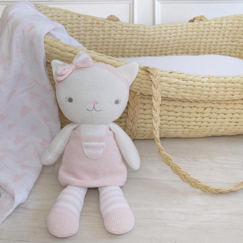 Knitted Cat sitting waring pink dress and pink and white hair bow