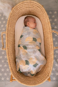 baby swaddled in patches muslin wrap