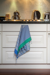 Knidos Collection Turkish Hand Towel hanging from kitchen