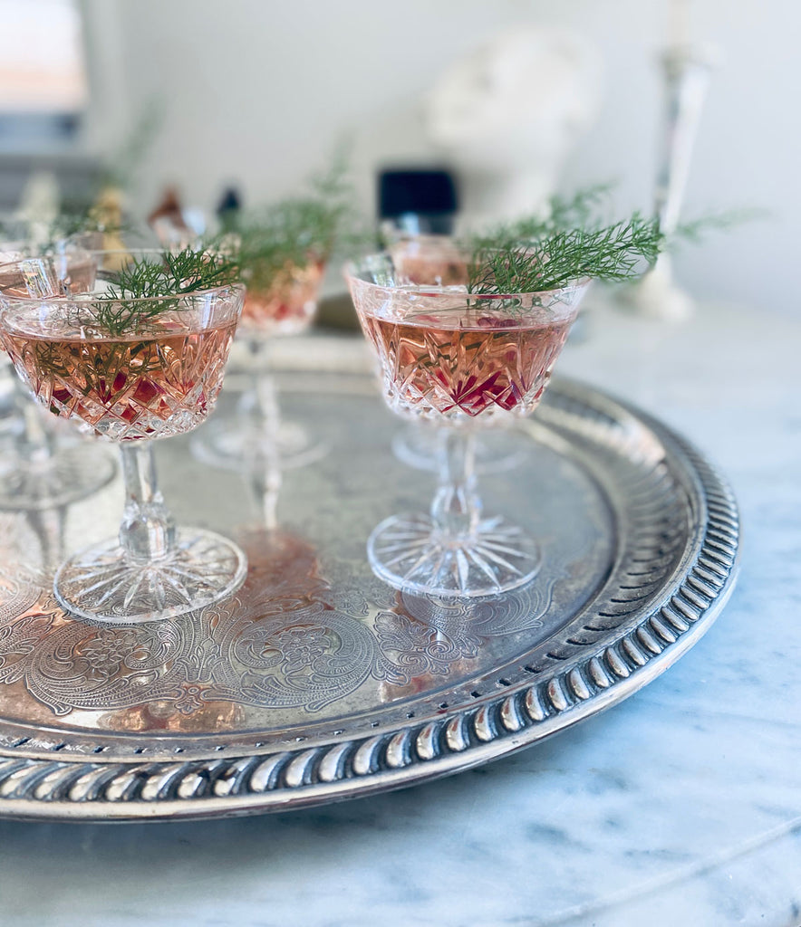 Pink Gin Christmas Cocktail in glasses on silver tray