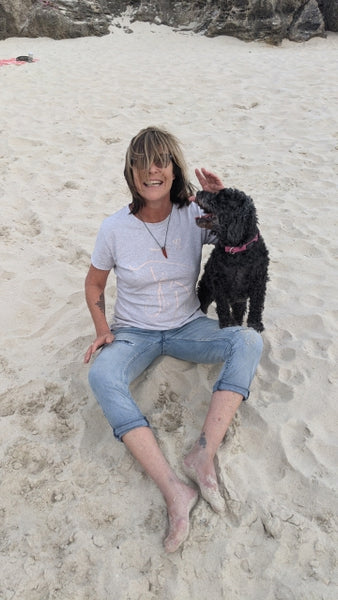 Jodie Cooper wears the Purposeful organic Cotton T-Shirt on the beach