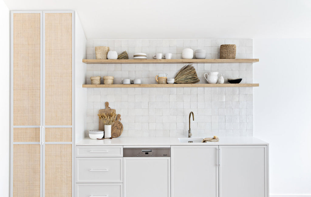The rattan doors and tiled splash back in the kitchen of The Cape Beach House in Byron Bay