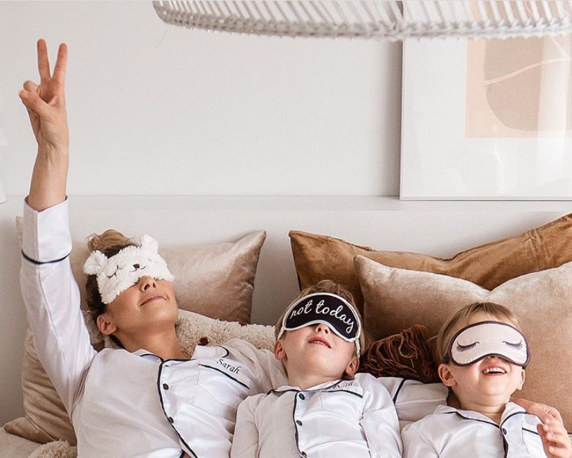 Sarah from @thebearcubclub and her twin boys in their pyjamas and sleep masks