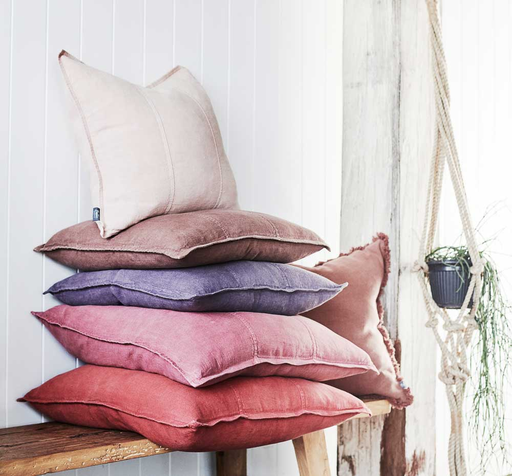Luca Linen cushions stacked on a bench seat