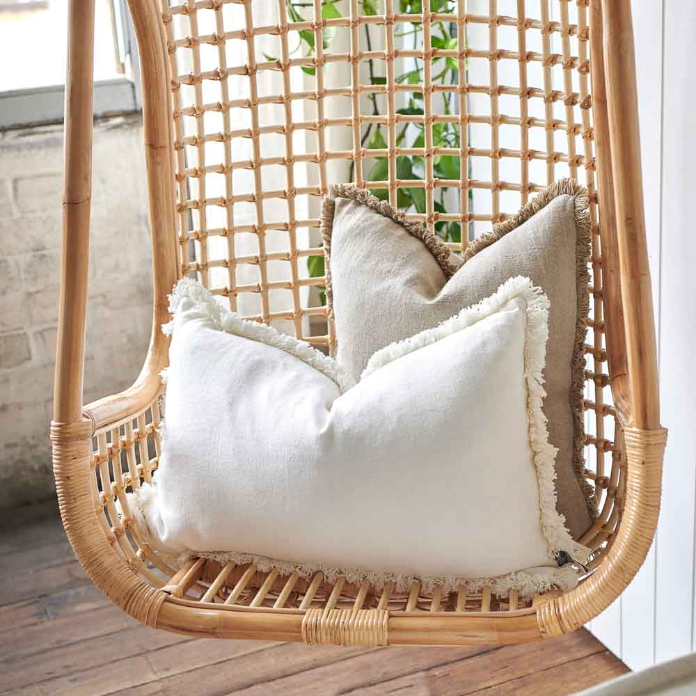 Luca Boho Linen Cushions in White and Natural on hanging chair