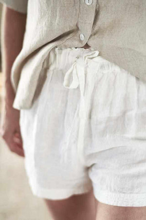 Tie waist on white linen shorts